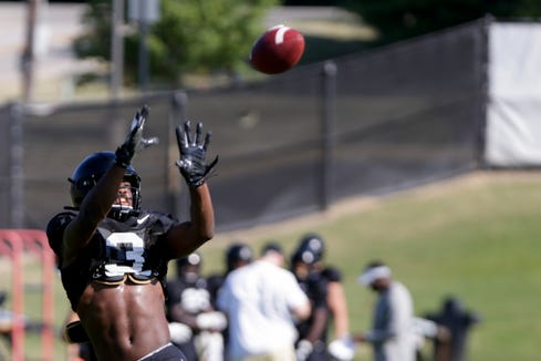 Purdue wide receiver David Bell (3) leaps up to catch a pass during practice, Friday, Aug. 9, 2019 at Bimel Practice Complex in West Lafayette.