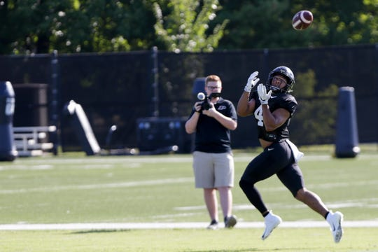 Purdue wide receiver Rondale Moore (4) runs down the field to make a catch during practice, Friday, Aug. 9, 2019 at Bimel Practice Complex in West Lafayette.