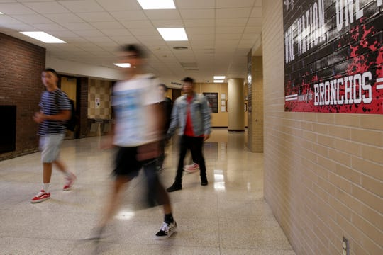 Students walk through the halls of Lafayette Jefferson High School after the final period of the day, Friday, Aug. 9, 2019 in Lafayette.