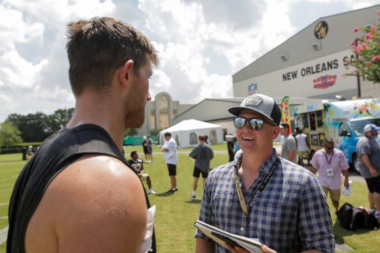 USA Today Network reporter Luke Johnson interviews New Orleans Saints long snapper Zach Wood following a training camp practice at the Ochsner Sports Performance Center.