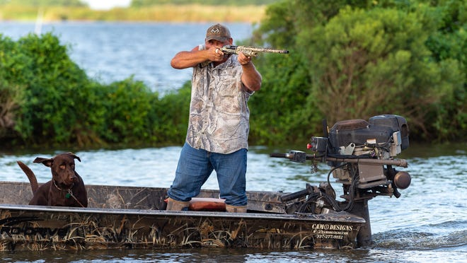 Justin Choate hunts nutria from his boat in the wetlands near the Louisiana coast Aug. 8.