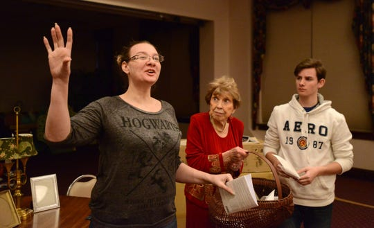 "Rosemary Hajost, center, and Orion Carter, right, portraying Florence Foster Jenkins and Comse McMoon respectively, listen to Lee Carter, left, portraying Dorothy, as they rehearse a scene from ""Glorious"" last year at the Wilson Ballroom in Lancaster. The playhouse board is looking for a bigger space for its productions."