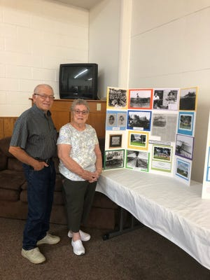 """Dale and Carolyn Solt stand beside the display of """"The Shaking Prairie"""" sharing history of this land and printed pictures from glass negatives found in home when they purchased it in 1965, Cedar Hill Road, Amanda."""