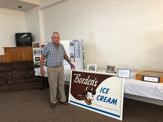 Jim Miller, Amanda Township Trustee stands by the Borden's Ice Cream sign that hung in front of Strayer Drug Store, Amanda.