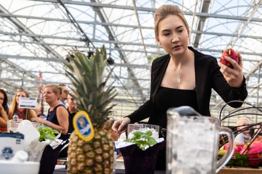 Marissa Vandaelen, a bartender at Diamonds Steak & Seafood and The Silver Pig in Howell, competes in a mixology competition for charity at Bordine's Nursery in Genoa Township, Aug. 8, 2019.