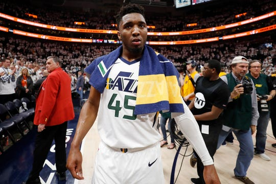 Apr 22, 2019; Salt Lake City, UT, USA; Utah Jazz guard Donovan Mitchell (45) walks off the court after their win against the Houston Rockets in game four of the first round of the 2019 NBA Playoffs at Vivint Smart Home Arena. Mandatory Credit: Jeff Swinger-USA TODAY Sports