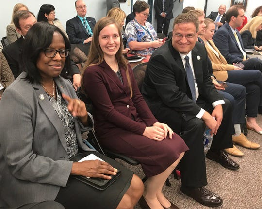 Adrienne Southworth sits next to Lt. Gov. Jenean Hampton and Steve Knipper at the Kentucky Personnel Board meeting on Friday, Aug. 9, 2019.