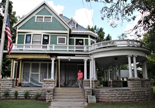 "Work continues on the $1.3 million restoration project at the Harding Home in Marion. Site Manager Sherry Hall stands on the porch where Warren G. Harding conducted his famous ""Front Porch Campaign"" in 1920 leading to his election as the 29th president of the United States."