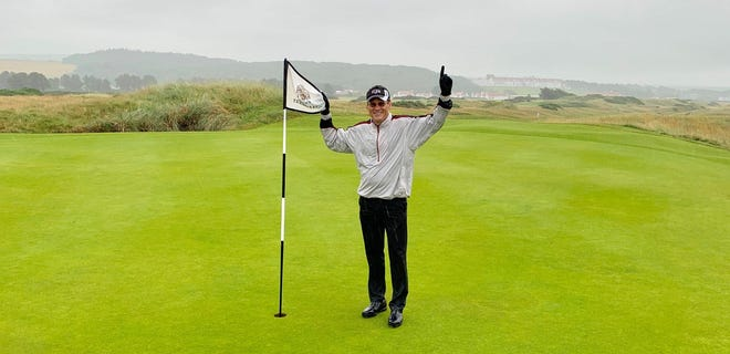 Dr. Bradley Campbell of Marion poses after hitting the first hole in one of his career. He did it at Trump Turnberry in Scotland, one of the most famous golf courses in the world.