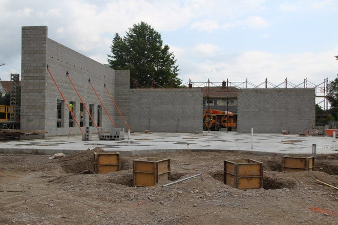 Crews from Thomas & Marker Construction have raised two walls of the Warren G. Harding Presidential Center in Marion. The windows on the wall to the left face East Church Street. The entire presidential site will open in May 2020, Site Manager Sherry Hall said.