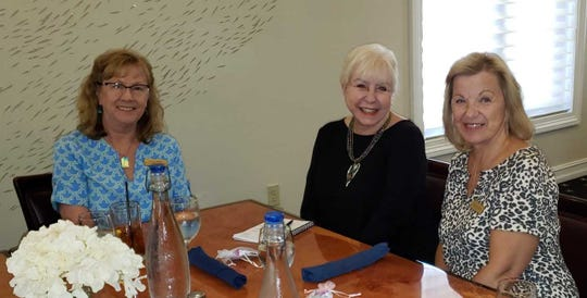 From left: Leesa Carls, Caitlin Robinson and the luncheon's hostess Pam Spering .