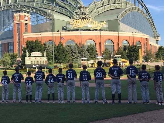 Members of the U-12 Glendale Little League team take the field at Helfaer Field outside Miller Park prior to a playoff game against Whitefish Bay.