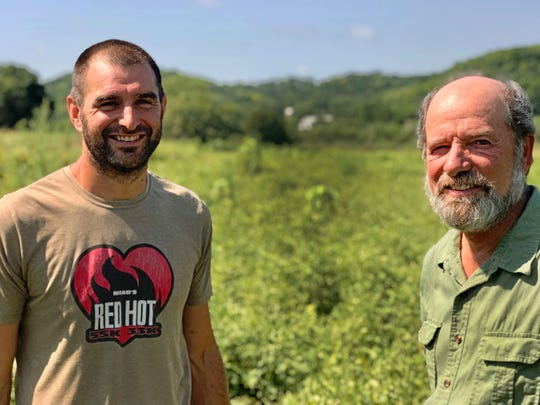 Jesse and dad David Perkins of Vermont Valley Community Farm in Vermont township look over their organic seed potato field.
