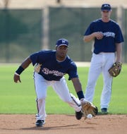 Milwaukee Brewers' Rickie Weeks catches a ground ball in front of Craig Counsell at baseball spring training Thursday, Feb. 21, 2008, in Phoenix.