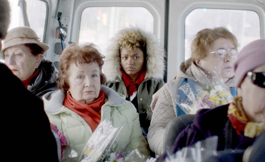 "Tracy (Lauren ""Lolo"" Spencer, center) is feeling cast aside when her transport van takes a detour to a Russian funeral in ""Give Me Liberty."""