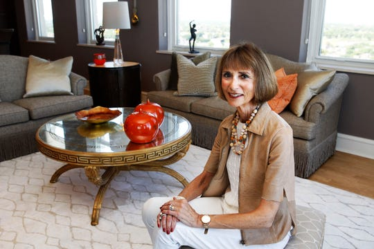 Betty Arndt relaxes in the living room of the condo she shares with her husband, Tom.
