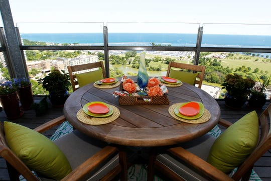 The Arndts make frequent use of their balcony patio, with its breathtaking view of Veterans Park on Lake Michigan.
