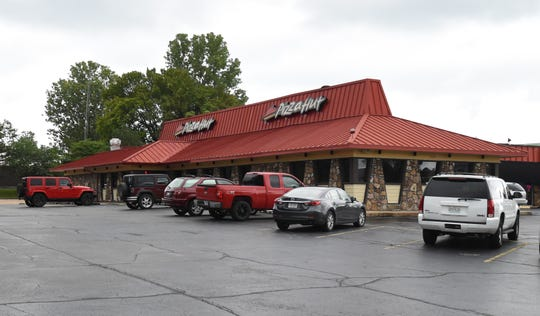 Mountain Home's Pizza Hut restaurant will not be affected by the company's plan to close almost 500 dine-in locations in the next two years, restaurant direct Alex Baugh said Friday.