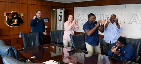 Auburn coaches from left, Gus Malzahn, Kenning Dillingham, Kodi Burns, Rodney Garner and Carnell Williams cheer during National Signing Day on Wednesday, Feb. 6, 2019 in Auburn, Ala.