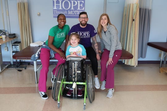 Annadelle with her therapists at Kennedy Krieger institute in Baltimore.