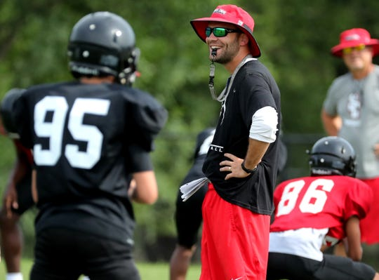Stewarts Creek's Ben Caudill (center) works with players during a 2019 practice. Caudill was named the team's head football coach Friday.