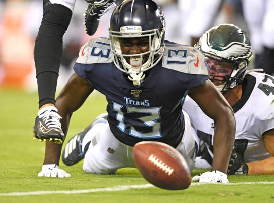 Tennessee Titans wide receiver Taywan Taylor (13) drops a pass as he's defended by Philadelphia Eagles linebacker Nate Gerry (47) during the first quarter of the preseason game at Lincoln Financial Field Thursday, Aug. 8, 2019, in Philadelphia, Pa.