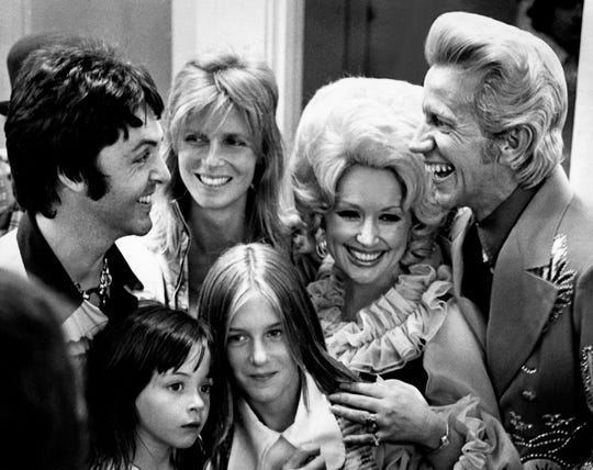Former Beatle Paul McCartney, left, and his family chat with Dolly Parton, second from right, and Porter Wagoner backstage during the third annual Grand Masters Fiddling contest at Opryland on June 16, 1974. McCartney's wife, Linda, and daughters Heather, 11, and Stella, 4, also enjoyed the music at the event.