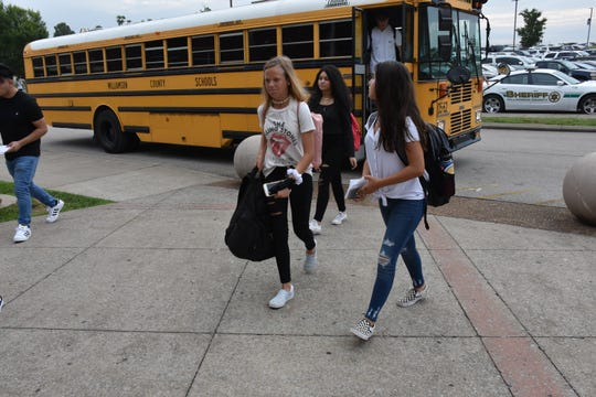 Freshmen Norika Pugh and Ava Amicone enter Independence High School on the first day of school in Williamson County Schools.