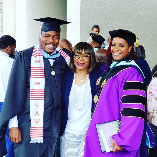 Family members Mychal Austin, Debra Johnson and Dr. Shernaye Johnson