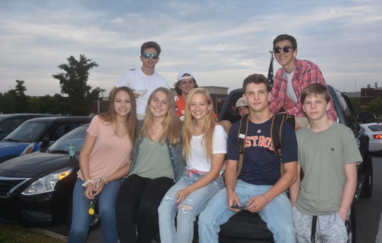 A group of friends meet before the bell rings at Independence High School on the first day of school in Williamson County Schools. (Left front) Sophie Hensiek, Kelsea Ittel, Nola Wiggins, John Greer, Rain Greer (Left back) Jesse Lampley, Dennis Tigg, Matt Giblin and Nico Lonergan.