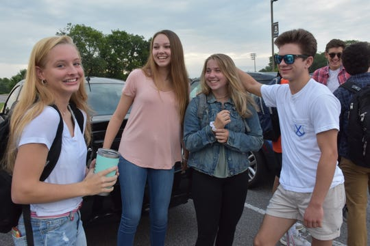 "Friends ""since first grade"" chat in the parking lot before classes begin at Independence High School on the first day of school on Friday. (Left)  Nola Wiggins, Sophie Hensiek, Kelsea Ittel and Jesse Lampley."
