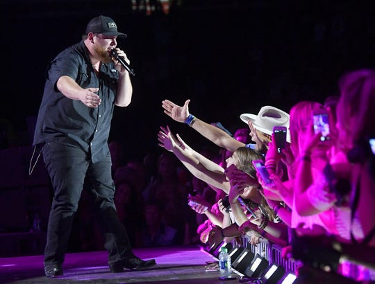 Luke Combs interacts with fans during his performance at the CMA Music Festival on June 8, 2018, at Nissan Stadium.