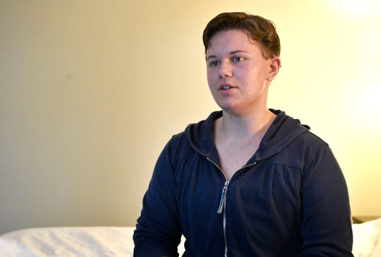 Yanna Awtrey finds himself alone in a hotel room after being dismissed from Welch College in Gallatin after having breast reduction surgery related to being transgender. Friday, Aug. 9, 2019, in Nashville, Tenn.