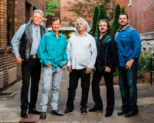 Pure Prairie League today, with John David Call in the center.