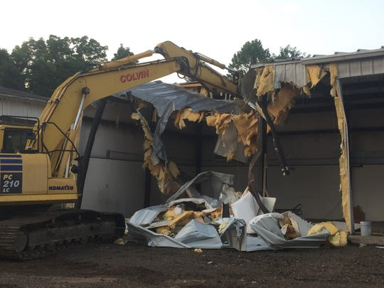 Demolition of the old service complex to make way for a new Granville fire station began early Friday morning, Aug. 9.