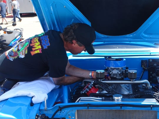 Paul Haye prepares his 1955 Plymouth Belvedere to race Friday during the Mopar Nationals at National Trail Raceway. The car is a tribute to Haye's mentor Ken Montgomery, a former Super Stock champion, and NASCAR legend Richard Petty.