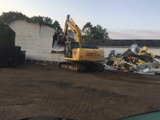 The Village of Granville's former salt shed is razed shortly after dawn on Aug. 9.