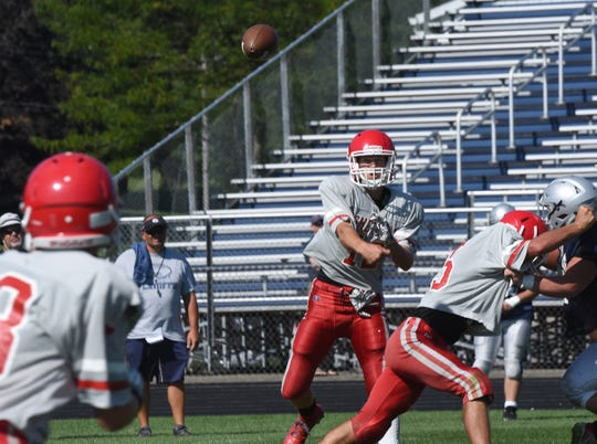 Sheridan junior quarterback Nate Johnson throws the ball during a pre-season scrimmage on Friday, Aug. 9, 2019 against Granville High School.