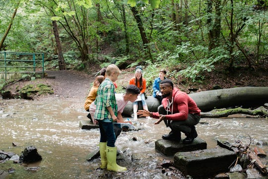 Hands-on ecology and animal programs bring textbooks to life for students.