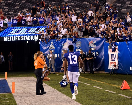 New York Giants wide receiver Reggie White Jr. (13) walks towards fans chanting his name after the Giants' win over the Jets. The New York Giants defeat the New York Jets, 31-22, in the first preseason game at MetLife Stadium on Thursday, August 8, 2019, in East Rutherford.