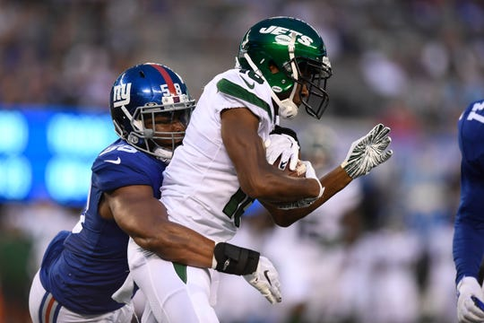 New York Giants linebacker Tae Davis (58) tackles New York Jets wide receiver Deontay Burnett (18).  The Jets face the Giants in the first preseason game at MetLife Stadium on Thursday, August 8, 2019, in East Rutherford.