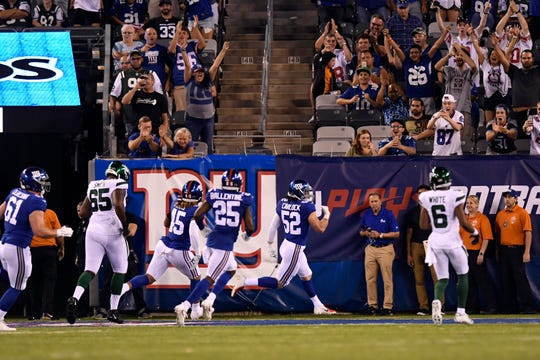 New York Giants linebacker Jake Carlock (52) scores a touchdown on an interception in the second half. The New York Giants defeat the New York Jets, 31-22, in the first preseason game at MetLife Stadium on Thursday, August 8, 2019, in East Rutherford.
