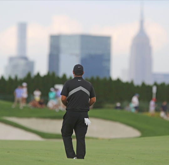Patrick Reed walks down the fairway on 18 while competing in the Northern Trust at Liberty National Golf Club in Jersey City on August 9, 2019.