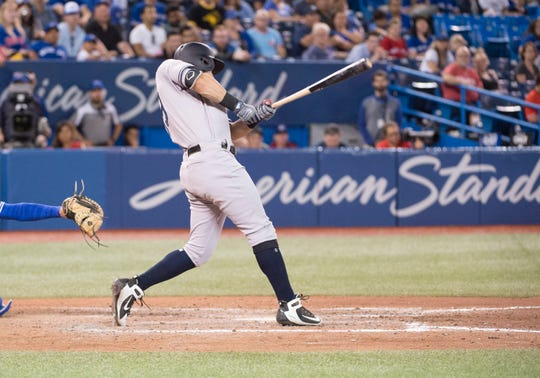 Aug 8, 2019; Toronto, Ontario, CAN; New York Yankees center fielder Mike Tauchman (39) hits a two run single with second base on a throw during the ninth inning against the Toronto Blue Jays at Rogers Centre.