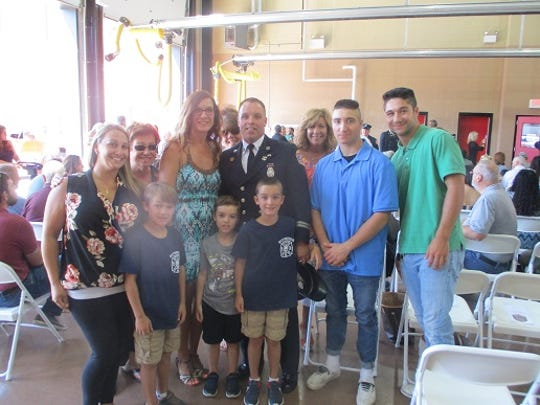 Newly promoted Paterson Fire Department Battalion Chief Kenneth Kiefer with his family  after an Aug. 9, 2019 promotion ceremony.