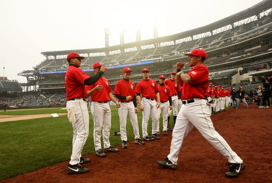 Gino Matias of the Red Storm is greeted by teammates as he is introduced before the start of the Georgetown Hoyas and St. John's Red Storm game at Citi Field on March 29, 2009 in the Flushing neighborhood of the Queens borough of New York City. This is the first event to be held at the new Citi Field.