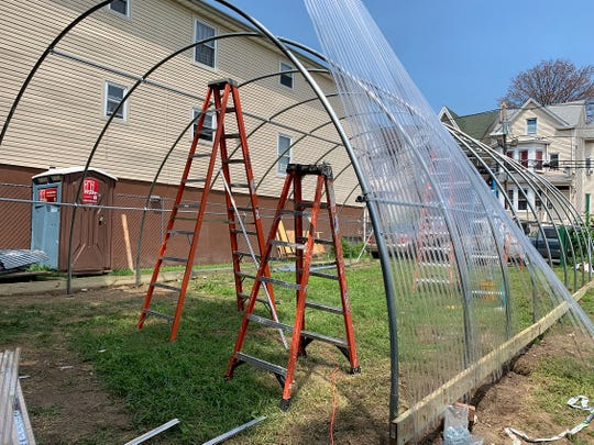 The greenhouse being built at the community garden in Paterson's 4th Ward.