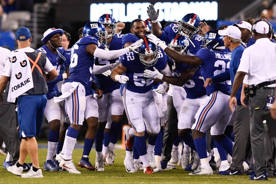 New York Giants linebacker Jake Carlock (52) is surrounded after a pick-six in the second half. The New York Giants defeat the New York Jets, 31-22, in the first preseason game at MetLife Stadium on Thursday, August 8, 2019, in East Rutherford.