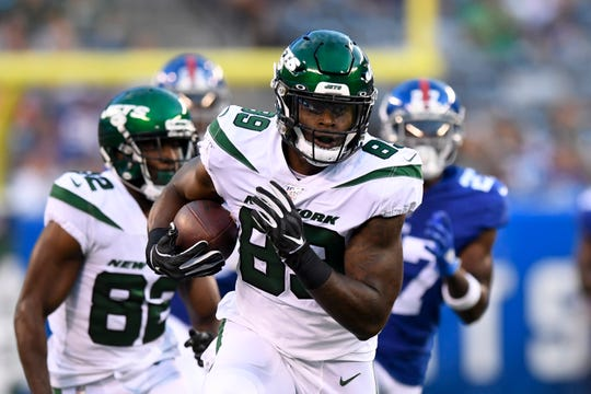 New York Jets tight end Chris Herndon (89) rushes against the New York Giants. The Jets face the Giants in the first preseason game at MetLife Stadium on Thursday, August 8, 2019, in East Rutherford.