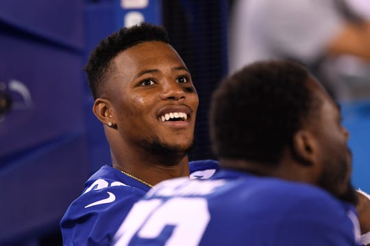 New York Giants running back Saquon Barkley watches from the bench. The New York Giants defeat the New York Jets, 31-22, in the first preseason game at MetLife Stadium on Thursday, August 8, 2019, in East Rutherford.